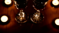 Wine glasses and burning candles video
