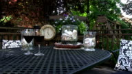 Wine glasses with clock at 5PM outdoor scene video