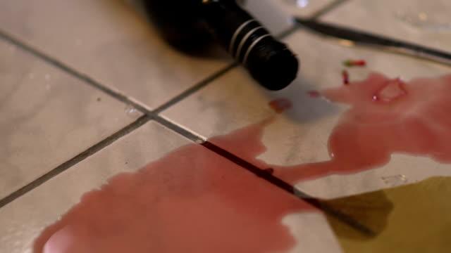 Wine poured from a bottle that rolls on the floor video