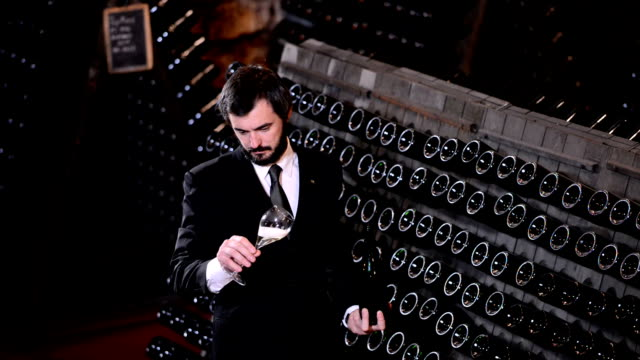 Winemaker with glass of wine video