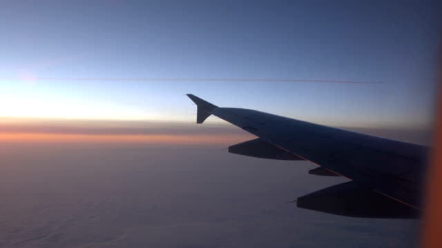 Wing of an airplane in the sunrise video