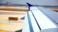 Wing of the plane on Runway video