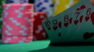 Winning combination, straight flush. Successful poker player checking his hand video