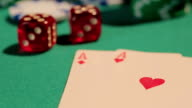 Winning hand of playing cards on poker table, pile of video