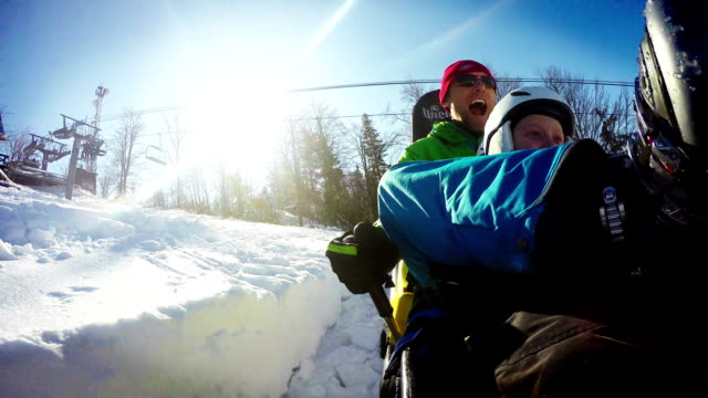 Winter Bobsleigh Roller coaster attraction. Father and son like crazy. video