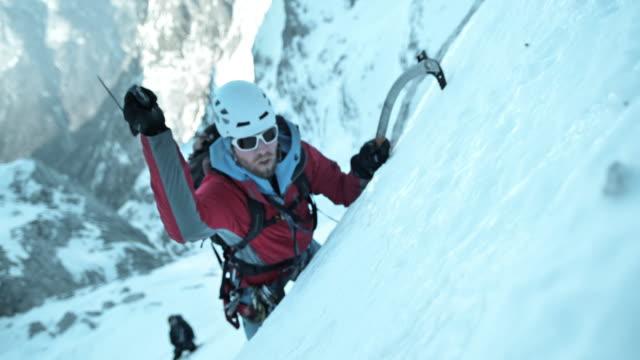 SLO MO winter climber using his ice axe video