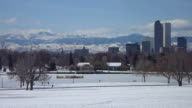 Winter Denver skyscrapers snowy City Park and Rocky Mountains video