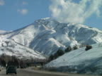 Winter Driving Through Snow Covered Mountain Range video