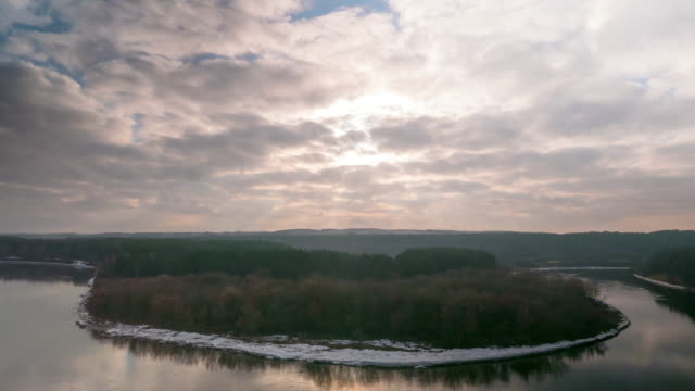 winter landscape, the river and the sun, time-lapse video