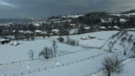 Winter scene, countryside village, aerial view video