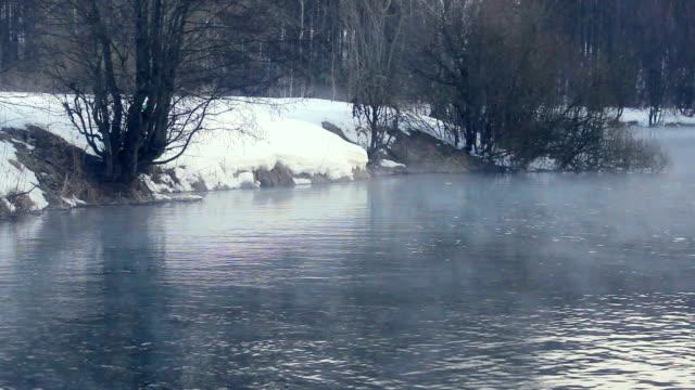 Winter scene. Fog over winter river. Forest river in winter. Misty morning video