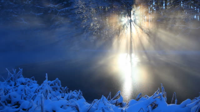 winter sunbeam on a small lake video