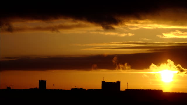 Winter sunset over the city. Sky scarlet due to frost. Smoke belching from the chimneys of heating plants. Time  lapse  footage. video
