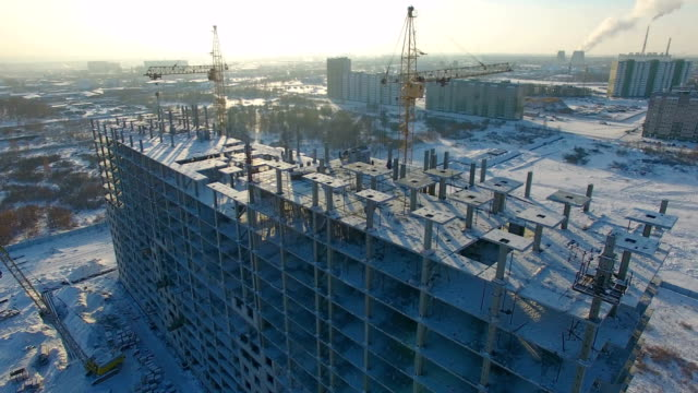 Winter view of a building under construction. video