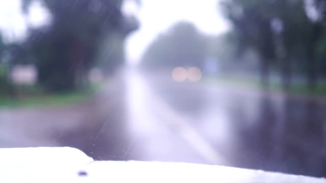 Wiping raindrops off a windshield in a car video