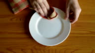 Wiping the plate after oranges video