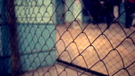 Wire fence. Closeup of steel net. Security protection barrier in shopping center video