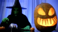 witch looking into magical orb,helloween video