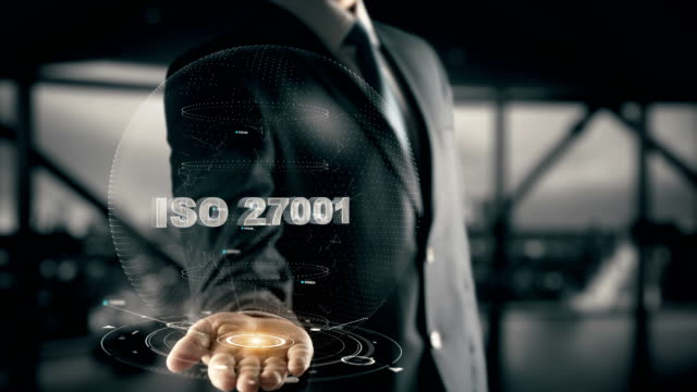 ISO 27001 with hologram businessman concept video