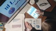 Woman Analyzing Financial Statistics video
