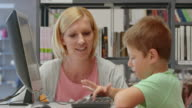 DS Woman and boy browsing on computer in library video