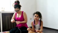 woman and a teen girl knit knitting lifestyle needlework video