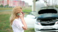 woman and broken car calling for help on cell phone. woman crying video