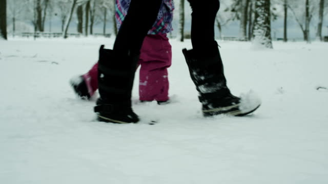 Woman and child walking in the snow video