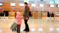 Woman and girl at airport video