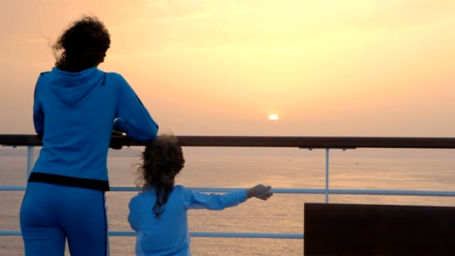 Woman and girl stands on deck video