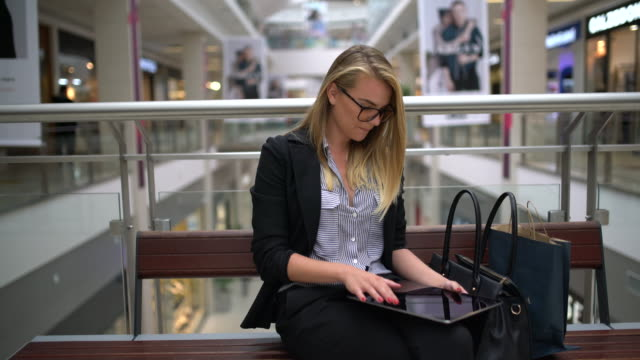 Woman and her digital tablet video
