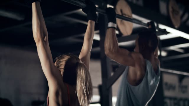 Woman and man doing chin-ups video