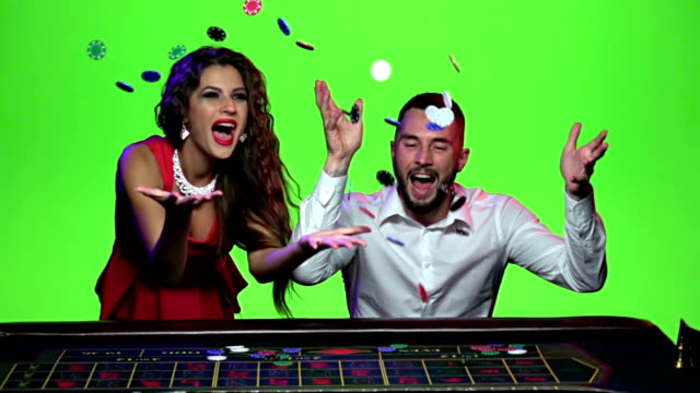 Woman and man playing in the casino win. Slow motion video