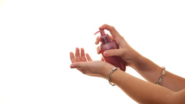 Woman applies cream on her hand video