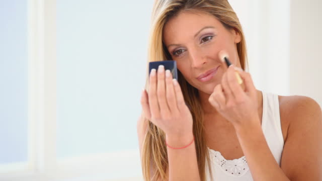 HD 1080 Woman applying face powder with a brush video