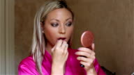 Woman Applying Lipstick video