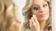 Woman applying mascara. video