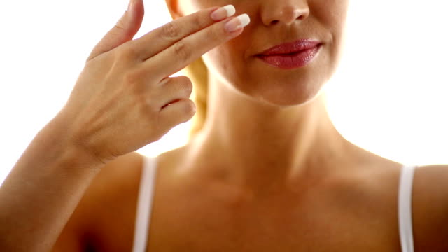 Woman applying moisturizer. video