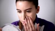 Woman applying powder video