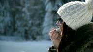 Woman applying protective lip balm video