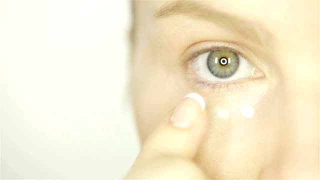 Woman Applying Skin Cream Under Eyes video