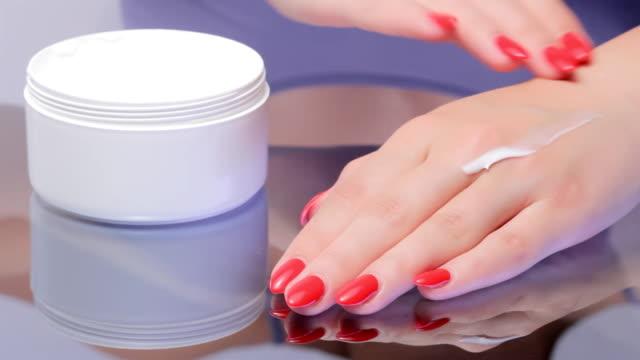 Woman Applying Skin Moisturizer on Hands. video