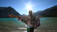 Woman arms outstretched in nature video