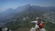 Woman arms outstretched on top of Lion's head video