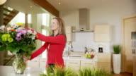 Woman arranges flowers video