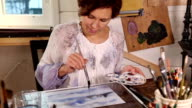 Woman artist drawing picture in studio video
