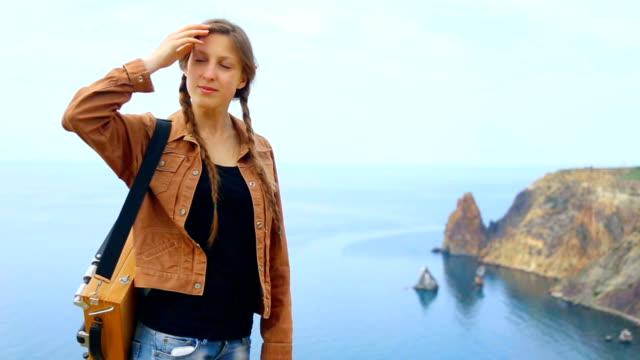 woman artist travels along the coast video
