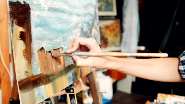 Woman artist working in her studio video