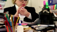 Woman as an administration economist in glasses tears commercial papers video