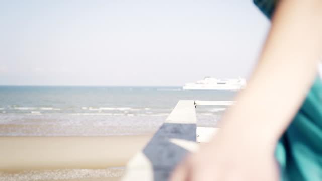 Woman at beach house video